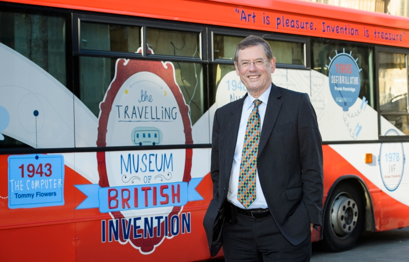 Roland Hill, Chairman and Managing Director of Contra Vision outside the bus.
